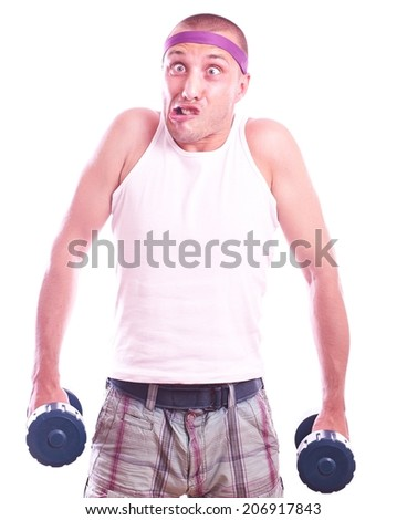 Portrait of a nerd guy trains with dumbbells - stock photo