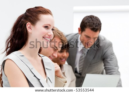Portrait of a nice business team working together in the office - stock photo