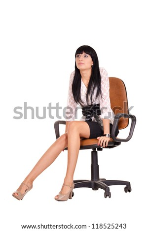 portrait of a nice businesswoman sitting on an office chair - stock photo