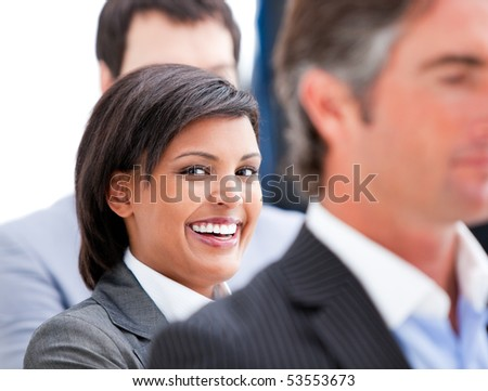 Portrait of a nice businesswoman smiling in the office - stock photo