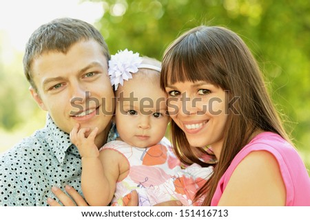 Portrait of a nice family in park - stock photo