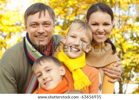portrait of a nice family on the nature - stock photo