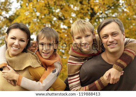 portrait of a nice happy family relaxing in autumn - stock photo