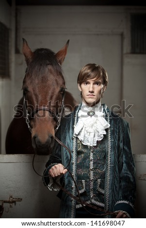Portrait of a nobleman and his horse. - stock photo