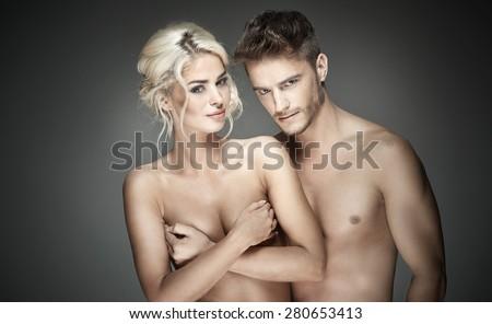 Portrait of a nude sensual couple - stock photo