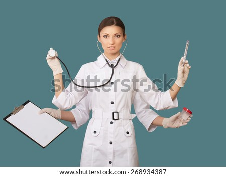 Portrait of a nurse with many hands, concept  - stock photo