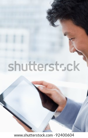 Portrait of a office worker using a tablet computer in his office - stock photo