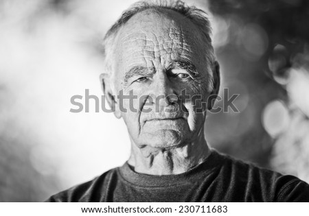 Portrait Of A Old Man Looking At The Camera - stock photo