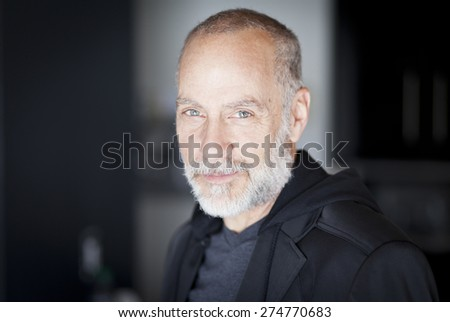 Portrait Of A Old Man Smiling At The Camera - stock photo