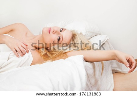 Portrait of a peaceful beautiful woman sleeping in bed resting  - stock photo