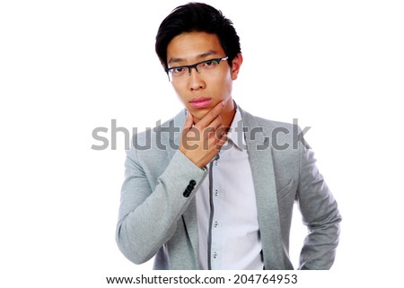 Portrait of a pensive asian man isolated on a white background - stock photo