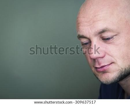 Portrait of a pensive bald man. Toned  - stock photo
