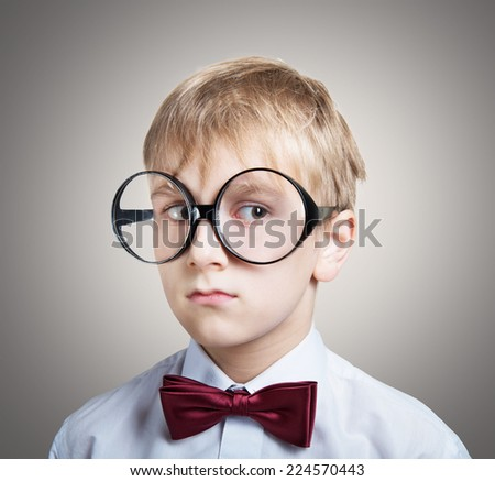 Portrait of a pensive boy in the bow tie looking away - stock photo