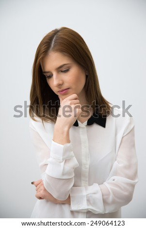 Portrait of a pensive businesswoman looking away - stock photo