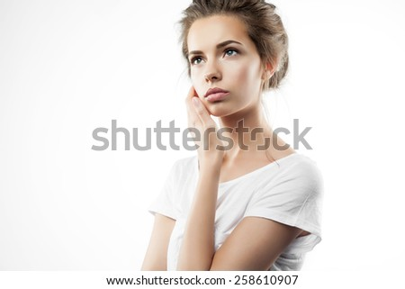 Portrait of a pensive girl in t-shirt - stock photo