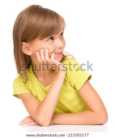Portrait of a pensive little girl supporting her head with hand and looking to the right, isolated over white - stock photo