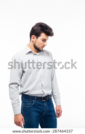 Portrait of a pensive young man standing isolated on a white background - stock photo