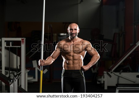 Portrait Of A Physically Fit Mature Male With Javelin - stock photo