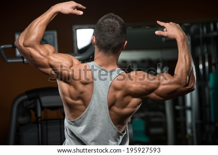 Portrait Of A Physically Fit Young Man - Flexing Muscles - No Pain No Gain - stock photo