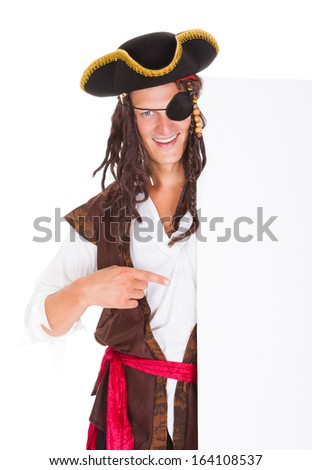 Portrait Of A Pirate Pointing At Blank Placard Over White Background - stock photo