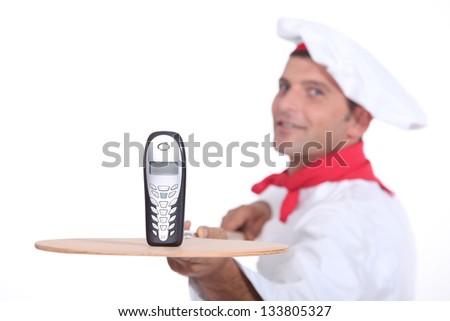 portrait of a pizza chef - stock photo