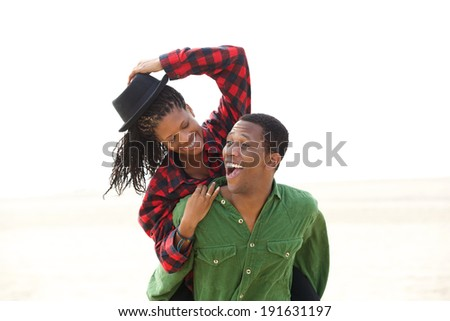 Portrait of a playful african american couple smiling outdoors - stock photo