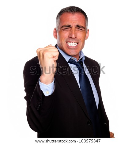 Portrait of a positive business man excited on black suit on isolated background - stock photo