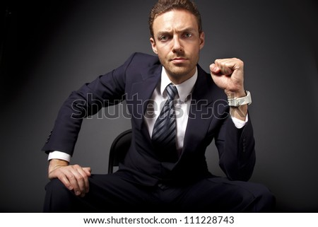 Portrait of a powerful businessman showing his strength. - stock photo