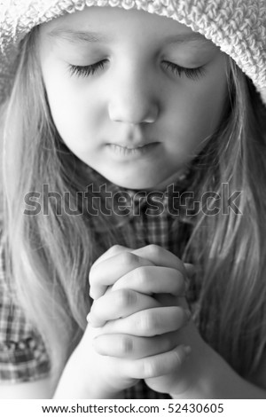 portrait of a praying girl - stock photo