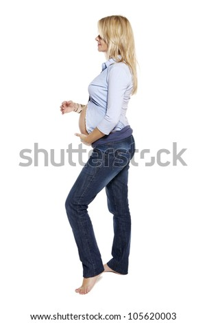 Portrait of a pregnant woman. Studio photo of pregnant woman isolated on white. - stock photo