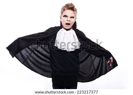 Portrait of a preteen Caucasian boy in vampire costume. Studio portrait isolated over white background - stock photo