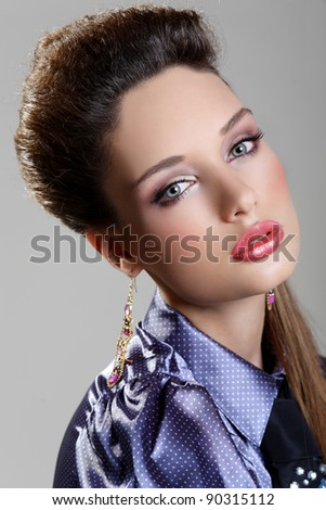 Portrait of a pretty brunette girl with blue eyes - stock photo