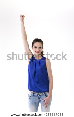 Portrait of a pretty Caucasian woman celebrating success. Isolated on white background.