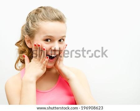 Portrait of a pretty enthusiastic girl - stock photo
