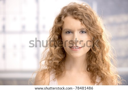 Portrait of a pretty girl, blond, long hair, blue eyes smiling.? - stock photo
