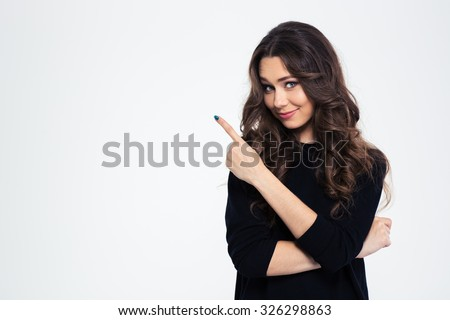 Portrait of a pretty girl pointing finger away isolated on a white background - stock photo