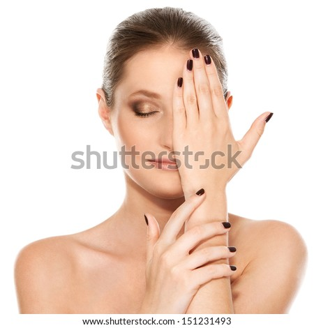 Portrait of a pretty girl with beautiful hands and face over a white background - stock photo