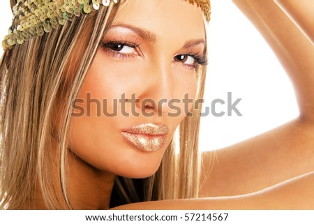 Portrait of a pretty girl with golden make-up - stock photo