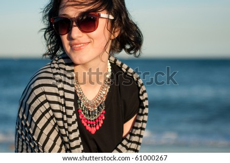 Portrait of a pretty girl with sun glasses - stock photo