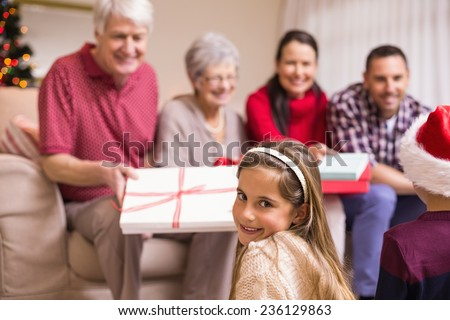 Portrait of a pretty little girl at christmas at home in the living room - stock photo
