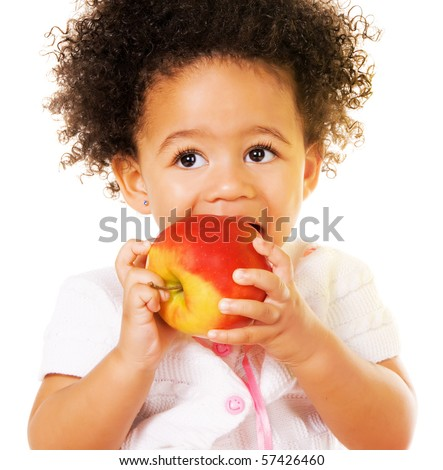 Portrait of a pretty little girl biting an apple - stock photo