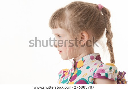 Portrait of a pretty little girl on white background, sideview - stock photo