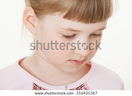 Portrait of a pretty little girl, white background - stock photo