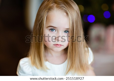 Portrait of a pretty serious girls baby blonde with straight hair, close up - stock photo