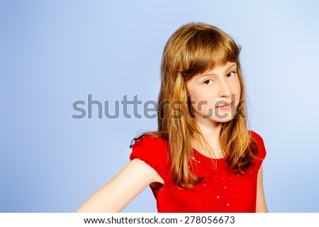 Portrait of a pretty ten years girl smiling at camera. Studio shot. - stock photo