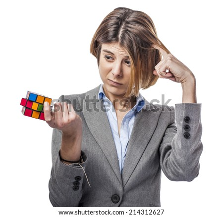 portrait of a pretty woman holding a rubik cube - stock photo
