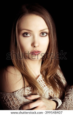 Portrait of a pretty woman in knit sweater / Woman - stock photo