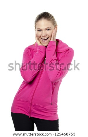 Portrait of a pretty woman with her pink sweater and cute gesture against white background - stock photo
