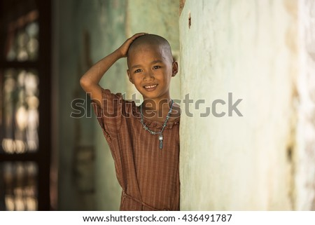 Portrait of a pretty 11 year or poor bald girl smile - stock photo