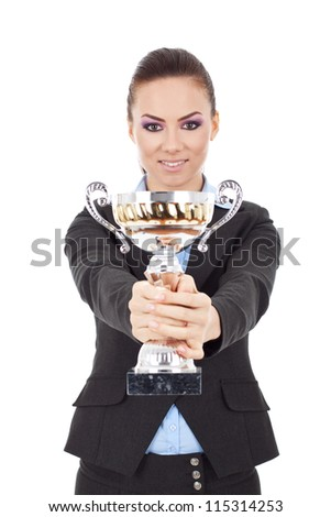 Portrait of a pretty young business woman with trophy award against white background - stock photo
